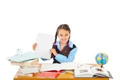 Documento felice di esposizione della scolara con A+ Immagine Stock