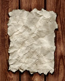 Documento sobre la pared de madera Foto de archivo libre de regalías