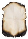 Documento viejo quemado sobre blanco Foto de archivo