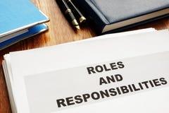 Documentos dos papéis e das responsabilidades fotos de stock