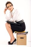 Documents. Successful young businesswoman sitting on pile of documents royalty free stock photos