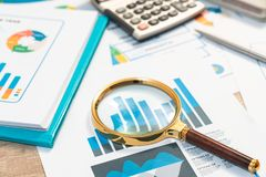 Documents with analytics data lying on table,selective focus stock photo