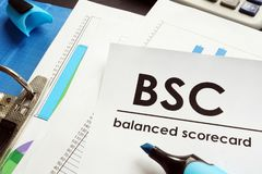 Documents about balanced scorecard BSC. Documents about balanced scorecard BSC on a table stock photo