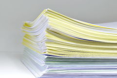 Documents on bookshelf Stock Images