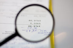 Documents, calculations and calculations by magnifying glass. On a white background Royalty Free Stock Photo