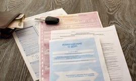 Documents on car insurance Royalty Free Stock Photos