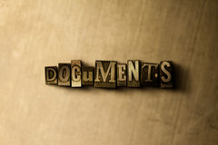 DOCUMENTS - close-up of grungy vintage typeset word on metal backdrop Royalty Free Stock Photo