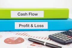 Documents de flux de liquidités, de bénéfice et de perte avec des rapports Photos libres de droits