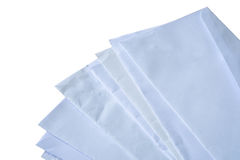 Documents and envelopes stacked on background. Documents and envelopes stacked on white background royalty free stock image