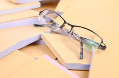 Documents and eye glasses Stock Image