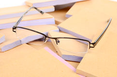 Documents and eye glasses Stock Photos