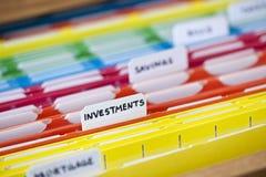 Documents financiers dans les dossiers Photographie stock