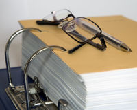 Documents, glasses and pen Stock Images