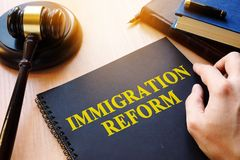 Immigration reform and gavel on a desk. Documents about Immigration reform and gavel on a desk royalty free stock images
