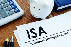 Documents about ISA Individual Savings Account. And pen stock image