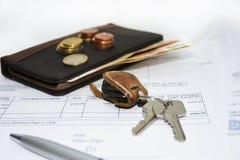 Documents with keys. Stock Photos
