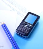 Documents and mobile phone Stock Photography