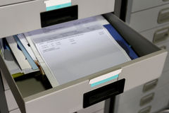 Documents in a office drawer. Some important documents in a office drawer stock images