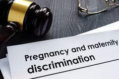 Documents about pregnancy and maternity discrimination. And gavel royalty free stock images