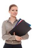Documents réussis de fixation de femme d'affaires Photo stock