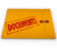 Documents Sealed Yellow Envelope Important Devliery Records. Documents stamped onto a confidential yellow envelope containing important papers, records Stock Images