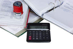 Documents with stamp and calculator Stock Photo