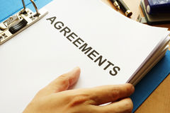 Documents with title Agreements. stock image