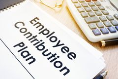Documents with title Employee Contribution Plan. Documents with title Employee Contribution Plan on a desk Stock Photos