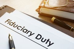 Documents with title fiduciary duty. Documents with title fiduciary duty on a desk Stock Images
