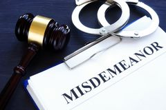 Documents with title misdemeanor and gavel. royalty free stock images