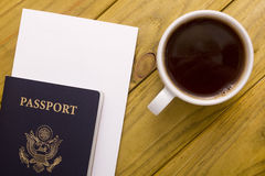 Documents for travel and a cup of coffee. Travel documents and cup of coffee on a wooden background Stock Photo