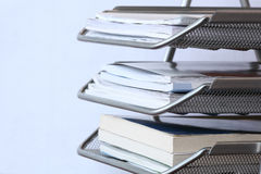 Documents in the tray. Office metal paper tray in white Stock Image
