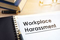 Documents about workplace harassment. Documents about workplace harassment in an office royalty free stock photo