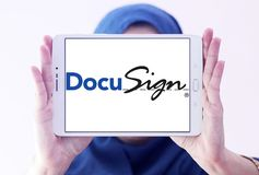 DocuSign company logo. Logo of DocuSign company on samsung tablet holded by arab muslim woman. DocuSign provides electronic signature technology and digital Royalty Free Stock Image