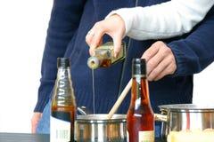 dodawanie trochę oleju Fotografia Stock