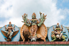 Goddess statue on big Hindu temple wall Stock Photos