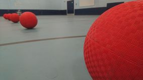 Close up of dodgeballs lined up stock photo