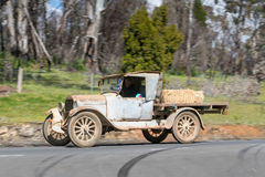 1923 Dodge 4 Buckboard driving on country road. Adelaide, Australia - September 25, 2016: Vintage 1923 Dodge 4 Buckboard driving on country roads near the town Stock Images