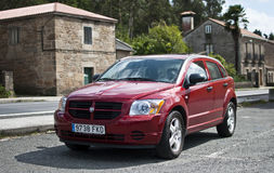 Dodge Caliber. Padrón, Spain - September 10, 2011 - Red Dodge Caliber 2.0 CRD on a blur background Royalty Free Stock Image