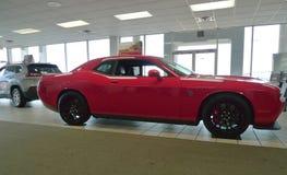 Dodge Challenger Hellcat on showroom floor. Flashy red Dodge Challenger Hellcat at Blue Ribbon Chrysler Dodge Jeep, Sallisaw, OK royalty free stock image