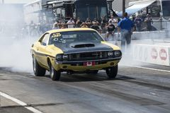 Dodge challenger making a smoke show at the starting line Royalty Free Stock Images