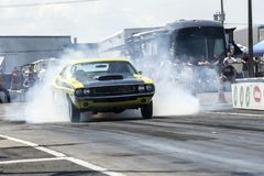 Dodge challenger making a smoke show at the starting line Stock Image