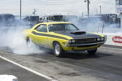 Dodge challenger smoke show on the track at the starting line Stock Image