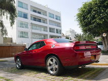 Dodge Challenger SRT8 392 Hemi in Miraflores, Lima. Lima, Peru. March 25, 2017. Rear and side view of a red mint condition Dodge Challenger SRT8 392 Hemi with a Stock Photo