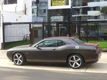 Dodge Challenger SRT8 392 Hemi side view, Lima. Lima, Peru. March 20, 2016.  Side  view of a gray and red mint condition Dodge Challenger SRT8 392 Hemi with a V8 Royalty Free Stock Photos