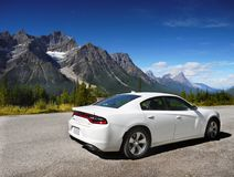Dodge Charger Car. White new Dodge Charger SE 2017, a large family sedan on the parking lot, side view. Alberta, Canada stock image