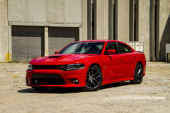 2015-2016 Dodge Charger R/T Scat Pack. A 2015 dodge Charger R/T muscle car in the Torred 'red' color featuring the 392 Hemi V8. This is a front 75 shot in an Royalty Free Stock Photos