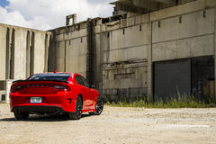 2015-2016 Dodge Charger R/T Scat Pack. A 2015 dodge Charger R/T muscle car in the Torred 'red' color featuring the 392 Hemi V8. This is a rear 75 shot in an Royalty Free Stock Photo