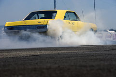 Drag racing. Napierville june 6, 2015 picture of classic dodge dart swinger making a smoke show on the track during challenger cuda owners association event Royalty Free Stock Image