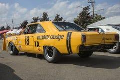 Dodge dart race car rear side view. Rear side view of yellow dodge dart race car in display during the U.S vintage grand prix at watkins glen international sept Stock Photo